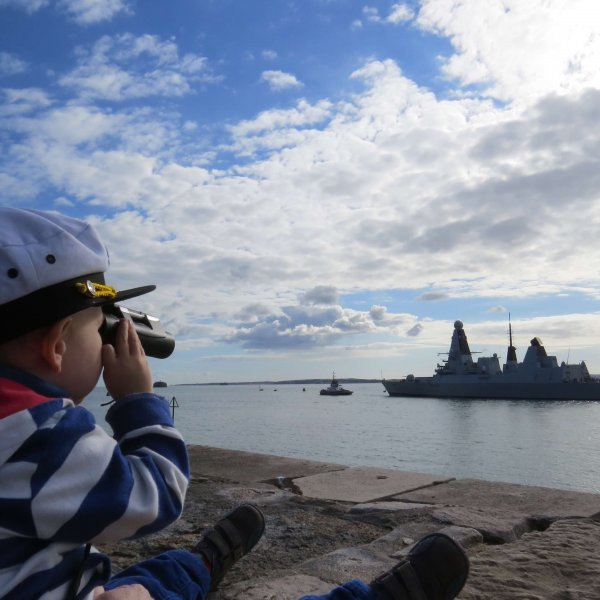 Harry (2), pictured in the Little Troopers 2020 calendar waving goodbye to his Dad's ship in Portsmouth harbour